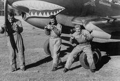 Flying Tiger AVG (American Volunteer Group) pilots and Tomahawk shark mouth nose art Ww2 Aircraft, Military Aircraft, Commonwealth, Volunteer Groups, Ww2 Pictures, Kunming, Air And Space Museum, Ww2 Planes, Nose Art