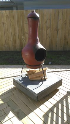Chimnea on wheeled base with paving slab to catch stray embers