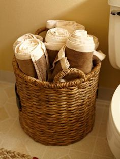 In a small space, woven baskets can offer much-needed storage for extra towels.  Greg stocked the bathroom with oversized outdoor pool towels in neutral colors.
