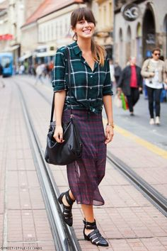 Shop this look on Lookastic: https://lookastic.com/women/looks/dress-shirt-midi-skirt-gladiator-sandals-crossbody-bag-watch/9519   — Teal Plaid Dress Shirt  — Gold Watch  — Black Leather Crossbody Bag  — Red and Navy Check Chiffon Midi Skirt  — Black Leather Gladiator Sandals