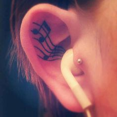 Inside the ear musical note tattoo