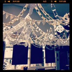 Paper chains, banners and  Bunting as Christmas decorations. Reminds me of the movie Elf!