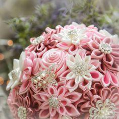 Satin broooch bridal bouquet close up. Special thanks to Keyzer Fotografie!
