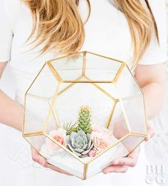 Learn how to craft a gorgeous terrarium centerpiece at home. This incredibly easy DIY project is the perfect addition to any wedding or party you're planning this summer.