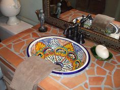 Terra Cotta RMSer Leanne Michael Interiors adds a Spanish influence to a bathroom with Saltillo tile and a hand-painted Talavera sink. Terra-cotta tile is one of the oldest tile materials and lasts a long time when well-made. Guest bath or half bath. Spanish Bathroom, Spanish Style Bathrooms, Spanish Style Homes, Modern Bathroom, Bathroom Sinks, Bathrooms Decor, Bathroom Ideas, Spanish Tile, Design Bathroom