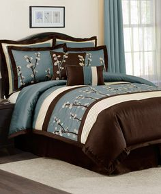 This is my bed and I just love it--not girly so my husband loves it also--Blue Cocoa Flower Comforter Set