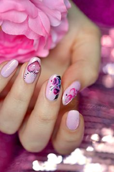 Pink nails with purple roses and red hearts