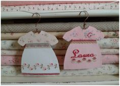 cute idea...fabric & cross stitch clothing decorations on mini hangers...baby shower?