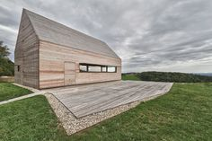 "This summer house located in Southern Burgenland, Austria was designed by Vienna based Judith Benzer Architektur to fit into its countryside surroundings, with a classic ""house"" shape and a traditional material taken to the next level."