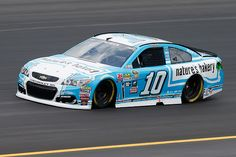 Danica Patrick driver of the Nature's Bakery Chevrolet practices for the NASCAR Sprint Cup Series Quaker State 400 at Kentucky Speedway on July 7...