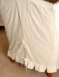 great tips for making slipcovers with canvas dropcloths including how to pre-shrink and bleach them.