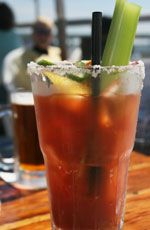Creole Bloody Mary    •1 cup vodka  •4-1/2 cups chilled tomato juice  •2 Tablespoons lime juice   •1 Tablespoon Worcestershire sauce  •4-6 dashes Tabasco hot sauce  •Celery salt and black pepper  •For garnish: celery stalks and lime slices