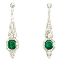 Tiffany Art Deco Emerald & Diamond Earrings, ca 1930.  A pair of Art Deco diamond pendant earrings of tapered design set with octagonal emeralds, in platinum.  Emeralds, 6.50 cts, & Diamonds, dtw 4.10 cts.