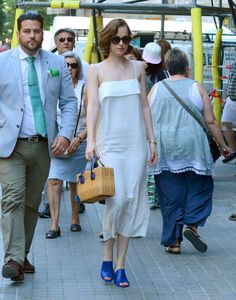 Dakota Johnson in a Apiece Apart dress while out in Barcelona. See all of the actress's best looks.