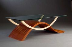 "Coffee Table    John Pennisi  Newfield, NY, Wave Form, 2010, East Indian rosewood (solid and veneer), mahogany, ash, and glass, 50""l x 20""w x 15""h"