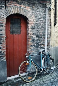 Bicycle parked outside a building in traditional old town center in Bruges, Belgium Mountain Bike Trails, Old Doors, Photography Website, Bruges, Old Town, Bicycles, Belgium, Landscape Photography, Beautiful Places