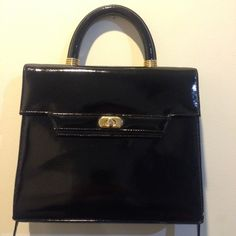 Vintage Black Gold Patent Split Leather Handbag New with tags, vintage condition. Black patent leather with gold accents. Turn closure in front, inside is lined with one zip pocket. Shoulder strap can be removed and can be used as a hand bag! I adore this but have serval like it! La Covina Bags Shoulder Bags