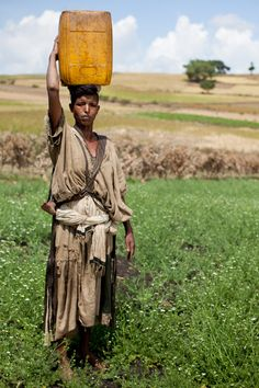 A woman collects drinking water in Agam Minch, Ethiopia. Follow us @: https://twitter.com/#!/everydaychild