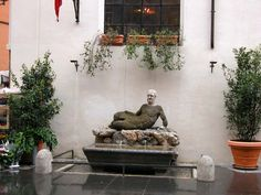 The little fountain with Babuino (the Baboon), one of Rome's ancient talking statues, in front of Caffe Canova Tadolini.
