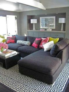 Dark grey with bright cushions & white walls!