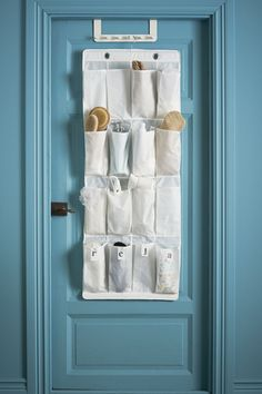 Save space in your bathroom with this tip! Put an IKEA SKUBB hanging shoe organizer on the back of your door to hold your hair brushes, beauty products and more!