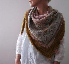 A girl's best friend is a triangular shawl worked flat from the top down! Find this lovely pattern and more knitting inspiration at LoveKnitting.Com.