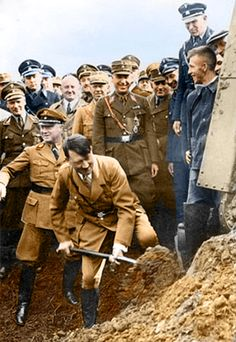 Hitler assists in the construction of the newly planned Autobahn freeway system. The Autobahn was part of the greater effort toward modernization of the Reich by the new National Socialist regime. This new road network offered rapid and consistent city connections throughout the Reich, later allowing for quick movement of military supplies for the the Blitzkrieg. Other nations like the U.S. later copied this German innovation through the construction of interstate freeway systems.