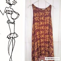 Egyptian Print Dress or Long Swing Top Egyptian Print Wine & Camel Swing Dress or Long Top. Has razor back w/wine pearl button @ neck. Light weight rayon material. Top has side pockets. Wear with khakis. Top runs big. Sadie & Sage Tops