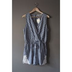 Striped Romper so so so cute! blue and white striped romper. elastic waistband. feels like linen. pretty crochet butterfly detail on the sides. pockets. has a small snap so you can keep the top closed. please note: this is a juniors size large but it fits like a regular size medium. may keep this so act fast! bundle and save! no trades please :) Dresses