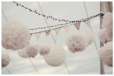 Love the white twinkle lights plus lanterns and different textures.  Little banner is cute too.