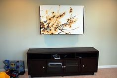 Hide your tv with ikea canvas! I like it!