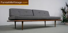 Retro Danish style day bed sofa. New seat cushions and upholstery. Bottom portion rests on a solid walnut wood platform. Remove the back cushions to create ...