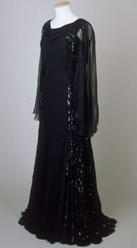 Sequined black silk crepe evening dress with silk chiffon sleeves, c. 1935-36.