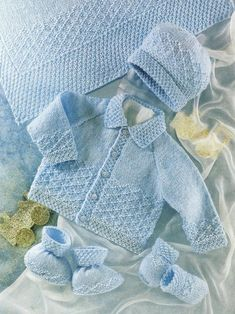 sirdar baby knit cardigan, hat booties, mittens, shawl