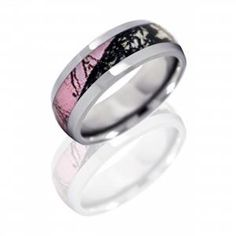 One of our newest pink camo rings available in titanium, black zirconium and cobalt chrome. To learn more visit us on facebook. https://www.facebook.com/jensenjewelersinc