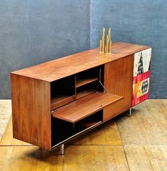 George Nelson; Walnut and Chromed Steel 'Thin Edge' Hi-Fi Cabinet with Sven Markelius 'Pythagoras' Fabric Speaker Cover for Herman Miller, 1950s.