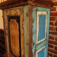 DIstressed armoire kinda like this in teals and golds. Turned out very pretty. Idea from cottage catalog