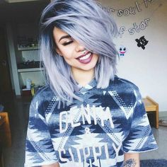 Cute blue grey dyed hairstyle with dark roots