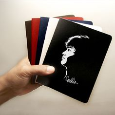 Mikha Angelo SILO Notebook    Actual size: 15 x 12 cm  Pages: 48 total with 8 pages in full color with pictures  Finishes: rounded edges, saddle stitched, foil stamped on cover  Colors: Black, White, Navy Blue, Red Maroon, and Brown  Total availabilty: only 500 pieces Limited edition.  Estimated prices: REGULAR EDITION Rp 49,000/each or Rp 149,000/set, SPECIAL EDITION with original signature from Mikha Angelo Rp 99,000/each or Rp 399,000/set  First come, first serve