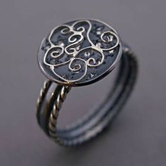 Todd Pownell: , Ring in sterling silver and platinum filigree with fifteen diamonds. Top is 12mm in diameter. Band is 4.5mm wide. Size 7 (may be custom ordered in your size, allow 3-4 weeks)