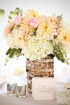 I really like the muted, pastel colors in the flowers. The whole look is very nice.