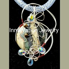 #Wire #wrapped #jasper #slider. #Silver-plated #copper #wire, #crystals. #37USD + shipping within US