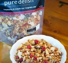 Raspberry & maple nut nograin-ola | Pure Delish pure delish raspberry & maple nut nograin-ola is a satisfying blend of 83% nuts and seeds coated with real Canadian maple syrup and nz honey to give it an exquisite crunch.  we then add a generous sprinkle of delicious freeze-dried raspberrie for an extra tangy burst of flavour.  #paleo #primal #glutenfree | www.puredelish.co.nz/where-to-buy/ Yummy Treats, Yummy Food, Canadian Maple, Freeze Drying, Maple Syrup, Glutenfree, Delish, Raspberry, Oatmeal