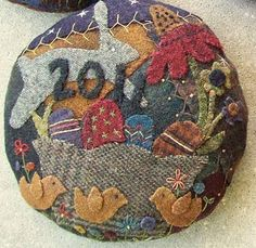 Wool Crazy pin cushion would love to try one of these as a hooked rug...