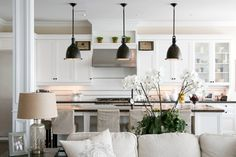 Love Your Kitchen Series--Glass Cabinets   ---Provident Home Design---love these pendents