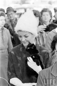 "Love this era, love the hats and gloves.  This comes from a ""black cat audition"" in Hollywood (for what movie?).  As the owner of a black cat, another reason to love this."