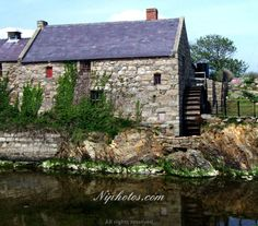 Corn mill and waterwheel at Annalong harbour, County Down, Northern Ireland.