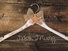 Distressed Beach Themed Wedding Hanger / Rustic Beach Bridal Hanger / Bride Hanger / Beach Wedding / Seashell Hanger / Personalized Hanger on Etsy, $40.00