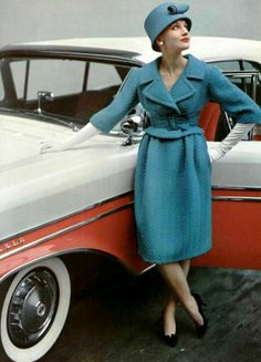 Model in turquoise wool suit with short jacket, wide leather belt and shirred-waist skirt by Givenchy, photo by Pottier, 1958