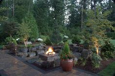 Sammamish, WA - 2012 After several design modifications this private back-yard oasis came to life. Our custom design included a gas-burning fire pit, raised paver patio, night lighting, privacy plantings, small water feature, and custom overhead structure